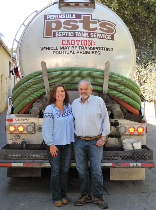 Photo of Father-Daughter owners of PSTS, with company truck behind them